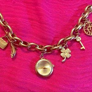 Anne Klein charm bracelet watch in gold color